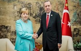 Меркель: Есть признаки ослабления напряженности